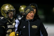 """Caledonia football coach Carl Fruechte worries about his players' mental health. He tells them, """"Come on over to my house and scream if you need t"""
