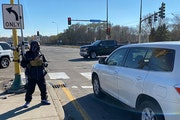 Shawn Bates panhandles at the intersection of Hiawatha Avenue and E. 46th Street in south Minneapolis in November 2020.