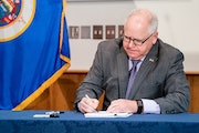 Minnesota Gov. Tim Walz, pictured at a bill signing, has extended the pandemic peacetime emergency for another 30 days. (Glen Stubbe/Minneapolis Star