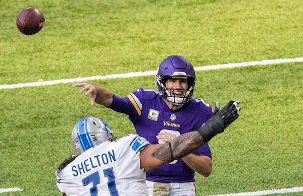 Minnesota Vikings quarterback Kirk Cousins (8) attempted a pass in the first quarter.