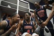 Auburn guard J'Von McCormick joked with teammates Malik Dunbar and Austin Wiley during media availability in the team locker room on Thursday