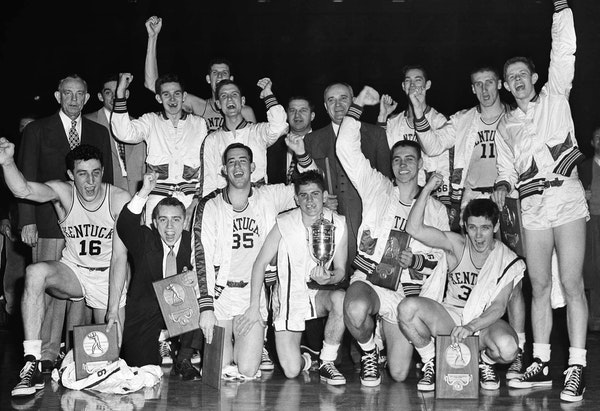 FILE - In this March 27, 1951, file photo, the Kentucky basketball team celebrates winning the NCAA college basketball championship after defeating Ka