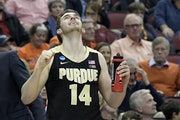 Purdue guard Ryan Cline celebrated in overtime. Cline fouled out in OT, but the Boilermakers did enough to hang on against Tennessee.