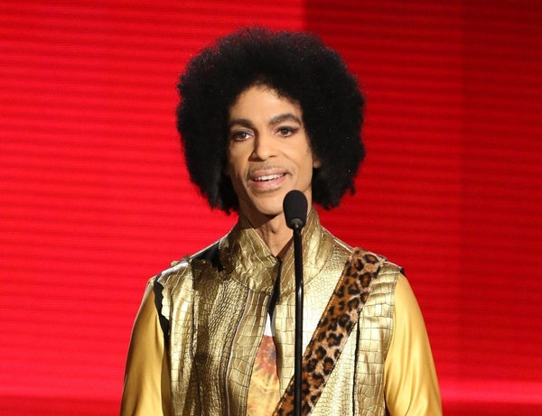 FILE - In this Nov. 22, 2015 file photo, Prince presents the award for favorite album - soul/R&B at the American Music Awards in Los Angeles. A TMZ re