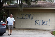 Private investigator Walter Zalisko, of Global Investigative group in Fort Myers, checks the Marco Island home of dentist Walter J. Palmer on Tuesday,
