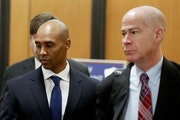 Former Minneapolis police officer Mohamed Noor, center, is accompanied by his attorneys Peter Wold, not pictured, and Thomas Plunkett, right, as he wa