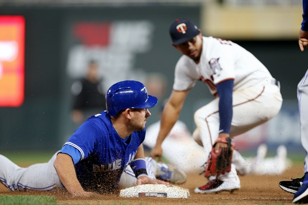 Toronto's Luke Maile stole third base in the 10th inning at Target Field on Tuesday