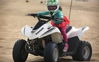 Nina Haley, 4, from San Francisco, rode on her own while her mother, Stacy Situ, watched from another ATV nearby at the Oceano Dunes State Vehicular R