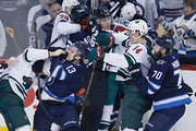 Left: The Wild went down swinging Friday in its Game 2 beatdown in Winnipeg.