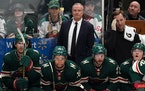 Minnesota Wild interim Head Coach Dean Evason watched from the bench in the second period.