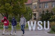 Students walk on the campus of Winona State University in September. CARLOS GONZALEZ • cgonzalez@startribune.com