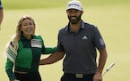Dustin Johnson walks with his wife, Paulina Gretzky, after winning the Masters golf tournament Sunday, Nov. 15, 2020, in Augusta, Ga. (AP Photo/Chris
