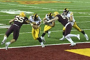 Iowa wide receiver Nico Ragaini ran the ball for a touchdown in the first quarter against the Gophers last Friday night.