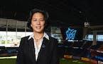 New Miami Marlins general manager Kim Ng poses for a photo at Marlins Park