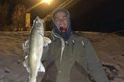 Luke Konson, above, and Daniel Balserak pulled their walleyes from the Minnesota River near Belle Plaine.