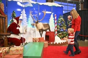 """Shannon Mueller, of Husdon, Wis., walked up to """"Santa Scott,"""" with her bashful 2-year old, Porter, and 5-month old, Rylan, before taking photos No"""