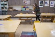Sophie Gray Spehar disinfected each table in her art classroom at Duluth's Piedmont Elementary School in September.