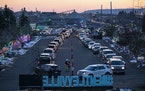 Hundreds of cars lined up early for opening night of the first ever drive thru Bentleyville in Duluth on Saturday.    ] ALEX KORMANN • alex.kormann@
