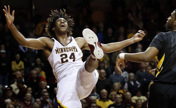 Gophers forward Eric Curry (24) was fouled by Iowa's Isaiah Moss in the second overtime Wednesday night at Williams Arena.