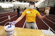 Volunteer Lauren Burroughs made sure this particular station was sanitized for the next person. At the U of MN Field House, about 2,000 students, staf