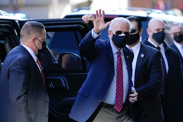 President-elect Joe Biden waves as he arrives at The Queen theater Monday, Nov. 23, 2020, in Wilmington, Del. (AP Photo/Carolyn Kaster)