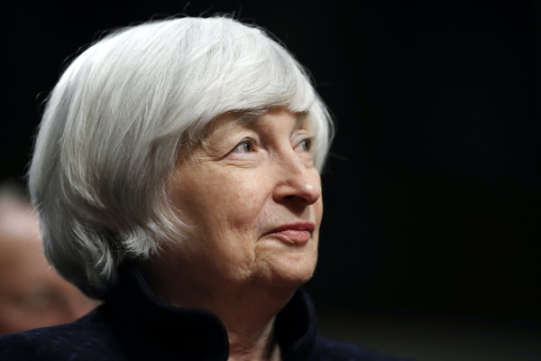 FILE - In this Tuesday, Nov. 7, 2017, file photo, Federal Reserve Chair Janet Yellen listens to introductions as she is awarded the Paul H. Douglas Aw