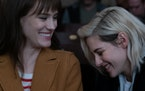 Abby (KRISTEN STEWART, right) and Harper (MACKENZIE DAVIS)  enjoy a moment at the movies in TriStar Pictures' romantic comedy HAPPIEST SEASON. ORG XMI