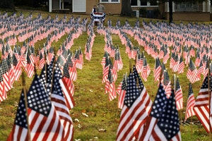 A total of 6,857 U.S. flags are placed in memory of the men and women who lost their lives in the wars in Afghanistan and Iraq on Monday, Nov. 9, 2015