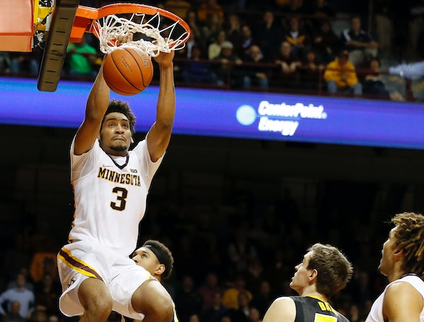 Jordan Murphy (3) dunked the ball in the second half.