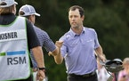 Robert Streb, right, fist-bumps Kevin Kisner after winning a second hole playoff at the RSM Classic golf tournament, Sunday, Nov. 22, 2020, in St. Sim