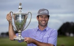 Robert Streb held the trophy after winning the RSM Classic on Sunday, his first PGA Tour victory since his initial Tour win six years ago.