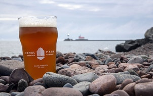 A Canal Park Brewery offering is pictured along the shores of Lake Superior.