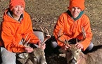Trey Mertens, left, and Mack Mertens are 13-year-old cousins from Roseau. On opening day of the statewide firearms season they each shot an 8-point bu
