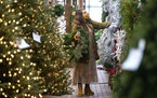 Amanda Perrone shops for Christmas decorations on Black Friday, at Corky's Garden Path Greenhouse in Scott Twp., Pa. on Friday, Nov. 27, 2020. (Chri