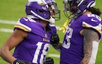 Minnesota Vikings wide receiver Justin Jefferson (18) celebrated with tight end Tyler Conklin (83) after he ran a pass from quarterback Kirk Cousins (