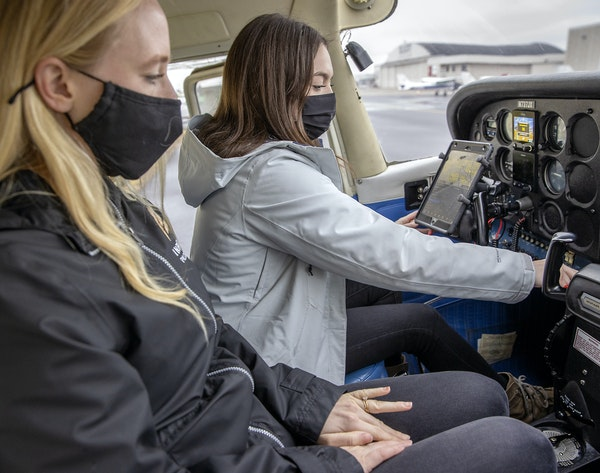 Sara Weidler, left, an instructor for Inflight Pilot Training, worked with student Shea Kieren, at the Elliot Aviation building at Flying Cloud Airpor