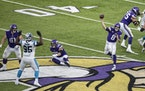 Minnesota Vikings quarterback Kirk Cousins (8) passed late in the fourth quarter.