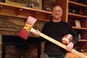 John Stock with his homemade replica of Paul Bunyan's Axe.