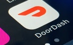 FILE - The DoorDash app is shown on a smartphone on Feb. 27, 2020, in New York. Delivery company DoorDash is looking for a valuation of nearly $30 bil