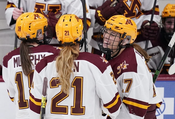 Gophers defenseman Josey Dunne (17) celebrated with forward Emily Oden (21) after she scored last weekend at home vs. Ohio State. Oden scored again Sa