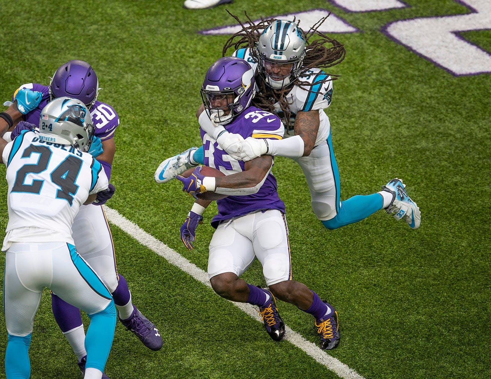 Tre Boston tackles Vikings running back Dalvin Cook in a November game.