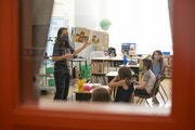 Lisa Larson read a book to her students on the first day of in-person class at Piedmont Elementary School on Sept. 21. Lisa Larson read a book to her
