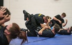 Trainees practiced ground-fighting techniques during defensive-tactics class at Fond du Lac Tribal and Community College in Cloquet, Minn.