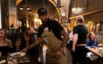 "RENEE JONES SCHNEIDER • renee.jones@startribune.com Chef Justin Sutherland during a 2019 ""Top Chef"" viewing party at his Handsome Hog restaurant"