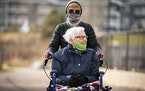 Lynda Lange took her mother MaryAnn Falk, 85, out for a walk around the McKenna Crossing Assisted Living facility in Prior Lake.