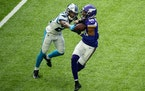 Minnesota Vikings wide receiver Justin Jefferson (18) caught a touchdown while being contested by Carolina Panthers cornerback Rasul Douglas (24) in t