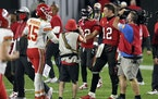Tampa Bay Buccaneers quarterback Tom Brady (12) congratulates Kansas City Chiefs quarterback Patrick Mahomes (15) after their NFL football game Sunday