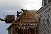 In this Feb. 26, 2018, photo, construction workers work on a new townhouse in Wood-Ridge, N.J.  (AP Photo/Seth Wenig, File) ORG XMIT: MIN2018041715464