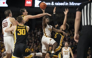 Minnesota Golden Gophers guard Marcus Carr (5) drove to the basket on Iowa Hawkeyes forward Cordell Pemsl (35).] Jerry Holt •Jerry.Holt@startribune.