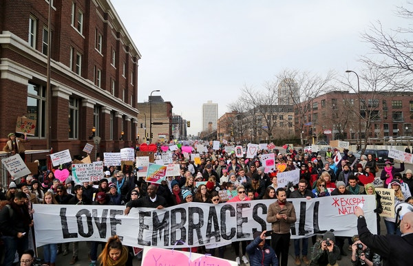The Caravan of Love: A Walk of Love for Immigrants and Refugees moved from the Minneapolis City Hall down Washington Avenue towards the Cedar-Riversid